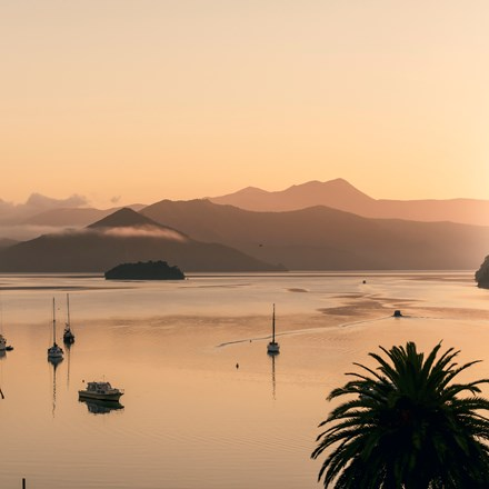 Orange sunrise over Picton Harbour and the Queen Charlotte Sound/Totaranui, at the top of New Zealand's South Island..